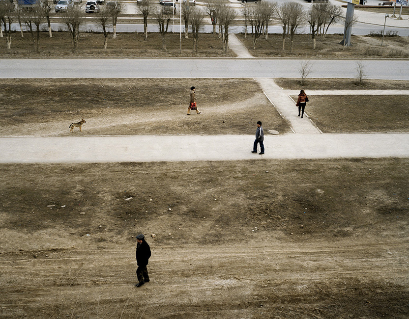 KAZAKHSTAN AtyrauPedestrians and dog.